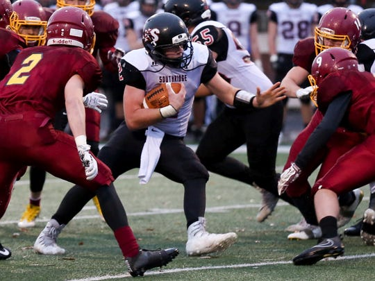 Southridge QB Jayce Harter (center) hurt Scecina through the air with timely passes.