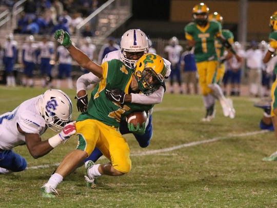 Coachella Valley's Angelo Fitzgerald carries the ball