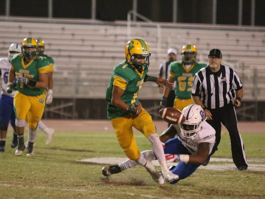 Coachella Valley's Armando Deniz recovers a dropped