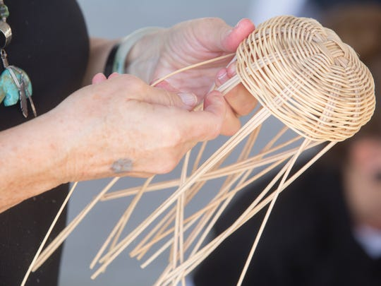 Members of the community learn basket weaving during the first annual Agua Caliente Band of Cahuilla Indian culture festival at Palm Springs High School.