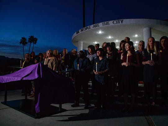 Members of the transgender community stand on the steps of Palm Springs City Hall at the Transgender Day of Remembrance vigil in  2017.