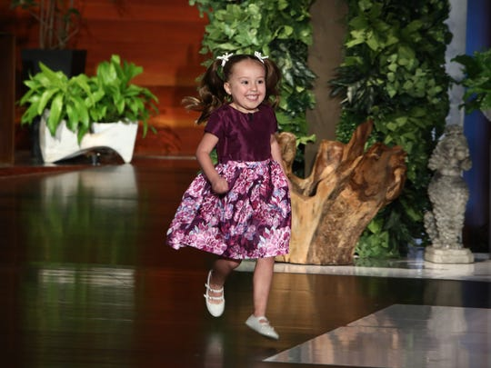 "In this photo released by Warner Bros., Brielle Milla runs onstage during a taping of ""The Ellen DeGeneres Show"" at the Warner Bros. lot in Burbank, Calif."