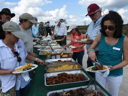 "Participants ""meat up"" in the buffet line. Environmentalists and preservationists gathered the Friday before Veterans Day for the annual Panther Island BBQ off Corkscrew Road, celebrating the restoration of thousands of acres of interior Collier County."
