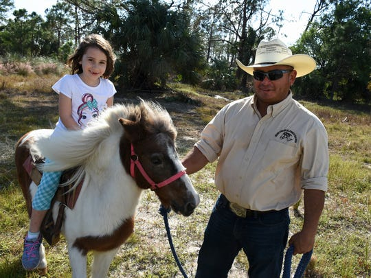 Maria Jose Manahan, 6, rides the world's gentlest pony. Environmentalists and preservationists gathered the Friday before Veterans Day for the annual Panther Island BBQ off Corkscrew Road, celebrating the restoration of thousands of acres of interior Collier County.