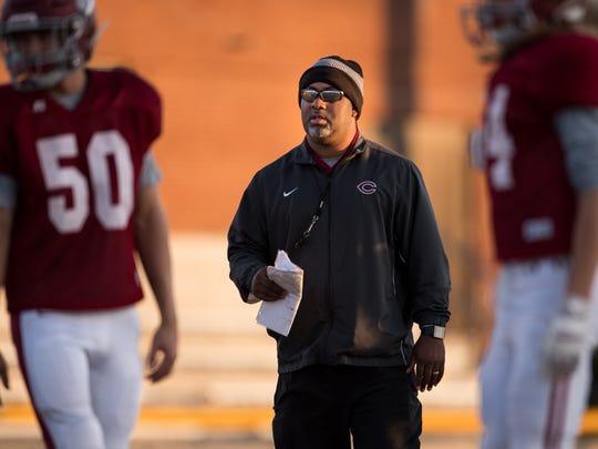 Cornersville coach Gerard Randolph keeps an eye on his players during practice at Cornersville High School in Cornersville, Tenn., Tuesday, Nov. 21, 2017.
