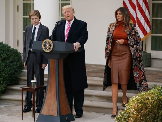 President Trump with son Barron Trump and first lady Melania Trump before pardoning the National Thanksgiving Turkey in the Rose Garden at the White House Nov. 21, 2017.