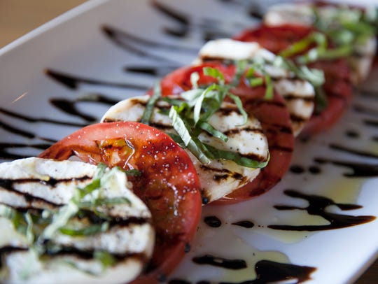 A caprese stack is one of the offerings at RELM Wine
