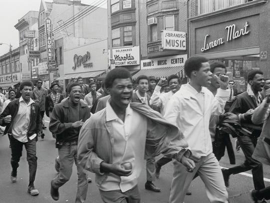 High school students flow up Market Street to attend a memorial service for Martin Luther King Jr. in Rodney Square in April 1968.