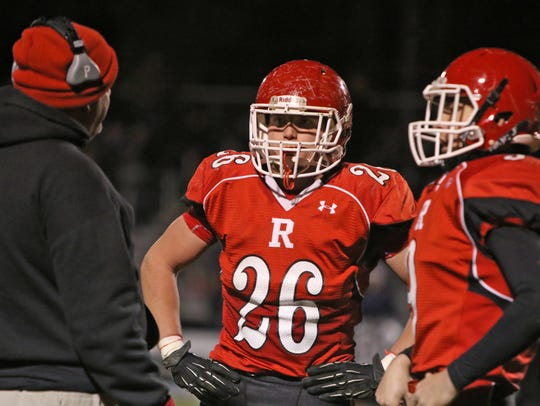 Riverheads players confer on the sidelines during the
