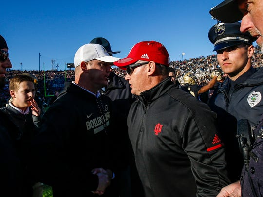 Purdue head coach Jeff Brohm shakes hands with Indiana head coach Tom Allen after the Boilermakers won the Old Oaken Bucket game at Ross-Ade Stadium in West Lafayette, Ind. on Saturday, November 25, 2017. The Boilermakers won 31-24.