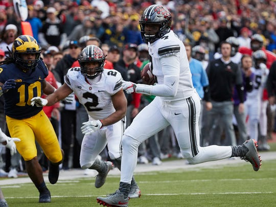 Freshman quarterback Dwayne Haskins, pressed into action for the injured J.T. Barrett, scrambles 22 yards to set up Ohio State's go-ahead touchdown against Michigan.