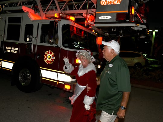 Mrs. Claus is escorted in from her fire truck. Santa