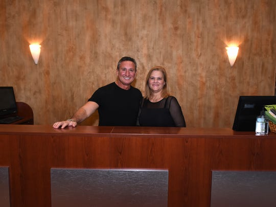 Co-owners Rick and Lisa Popoff behind the front desk. Rick's Island Salon and Day Spa, located at The Esplanade, has serviced Marco Island for 25 years.