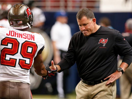 Tampa Bay Buccaneers head coach Greg Schiano greets cornerback Leonard Johnson (29) prior to a game against the St. Louis Rams at the Edward Jones Dome on Dec 22, 2013.