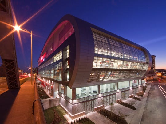 Some compare the curving shape of the KFC Yum! Center,