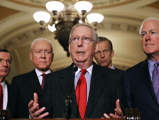 Senate Majority Leader Mitch McConnell (R-KY) with other Senate Republican leaders discuss their tax reform plan last month.