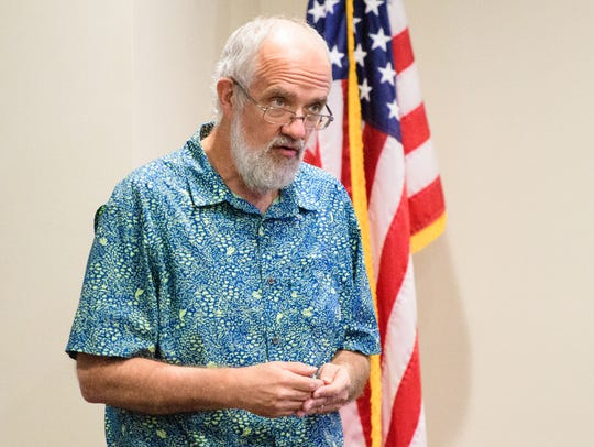 Paul Luberg speaks at the informational forum to discuss