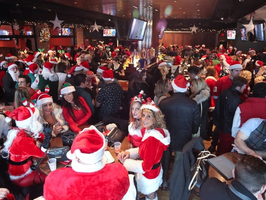 Royal Oak bars will be a sea of red Saturday afternoon during the annual Santa Pub Crawl.