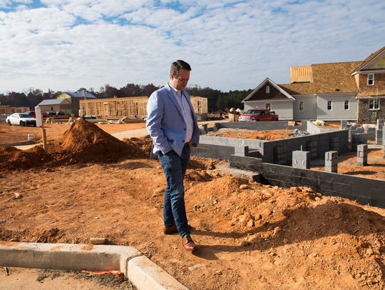 Matt Webber visits the site of his home as it is being built at the Hartness property in east Greenville on Thursday, Nov. 30, 2017.