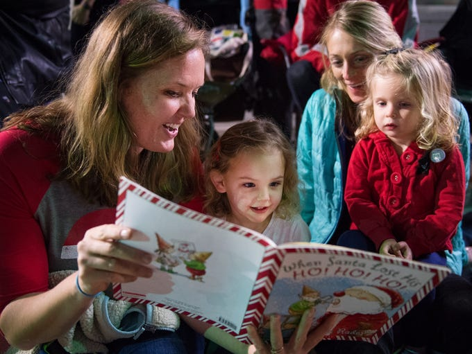 Elizabeth Campbell reads to Windsor Gibbs, 3, Amy Morrow,