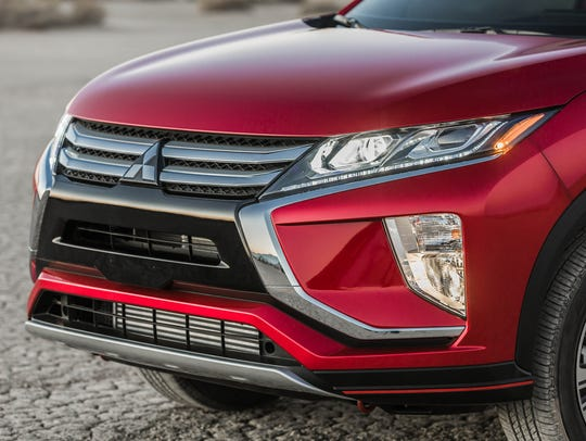 The Eclipse Cross's appearance is attractive and sporty. The grille features a big, shiny version of Mitsubishi's triple-diamond badge.