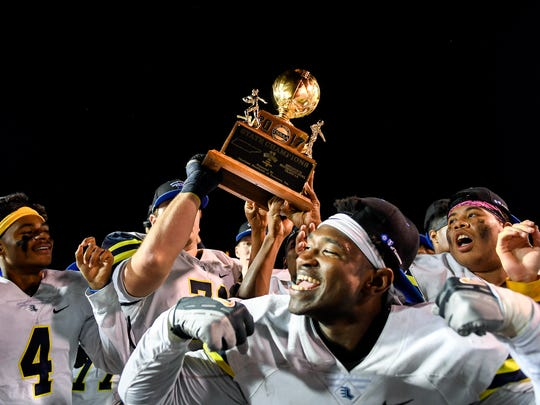 Lausanne players celebrate with their trophy after their Division II-AA state championship victory against Notre Dame at Tucker Stadium in Cookeville, Tenn., Saturday, Dec. 2, 2017.