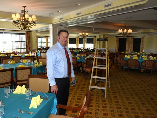 Clubhouse manager Bid Bakkar readies the dining room for a re-opening gala. The Island Country Club golf course reopened Dec. 1 after a $6 million renovation interrupted by Hurricane Irma.
