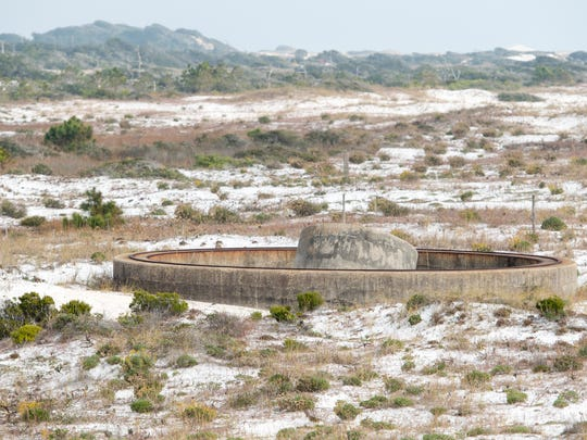 The remains of artillery foundations remain around the Battery Cooper area near Fort Pickens in Pensacola on Monday, December 4, 2017.  Lead from munitions once used at a firing range just east of the battery are among contaminants needing to be addressed at current and former military sites according to a recent report.