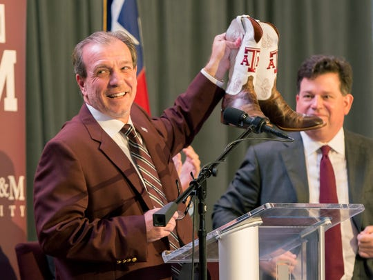 Texas A&M head coach Jimbo Fisher was gifted a pair of custom Texas A&M cowboy boots at the press conference held at the Hall of Champions in Kyle Field.