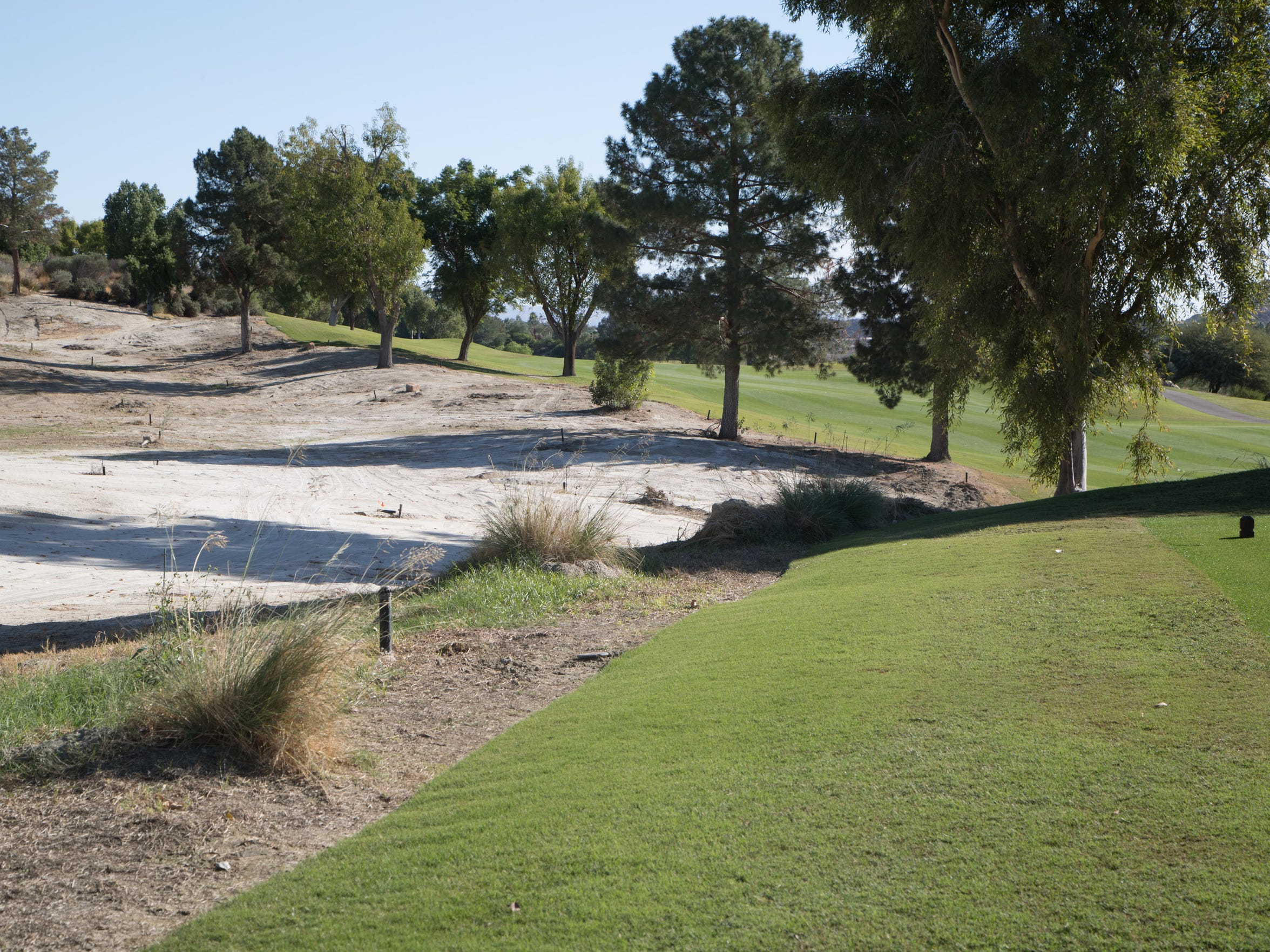 A large area of the Indian Wells Golf Resort, which was filled with wild grasses, will be replaced with mulch and drought resistant plants, December 5, 2017.