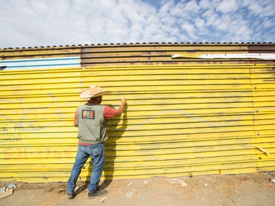 Enrique Chiu, a Mexican artist based in Tijuana paints the border wall separating Mexico and the U.S. in Tecate, Mexico. Chiu has painted along the border from Tijuana all the way east into Mexicali and plans to be able to paint all the way to Golf of Mexico where the border ends on the eastern part of both nations.