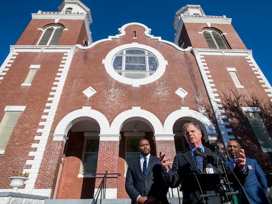 Democratic U.S. Senate candidate Doug Moor, flanked by  Selma Mayor Darrio Melton, left, and Former Massachusetts Governor Deval Patrick, right, speaks with the media at historic Brown Chapel AME Church in Selma, Ala. on Saturday December 9, 2017.