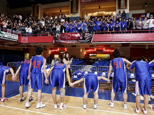 Members of the Keio basketball team thank their fans