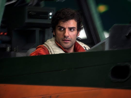 Poe Dameron (Oscar Isaac) in the cockpit of his X-wing