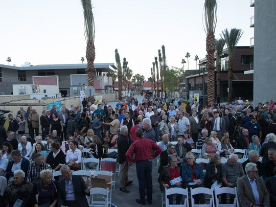 People gather for the ribbon-cutting ceremony for the