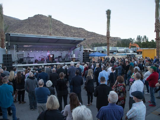 People gather for the ribbon cutting ceremony for the Palm Springs downtown project, Thursday, December 14, 2017.