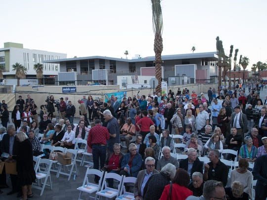 People gather for the ribbon cutting ceremony for the