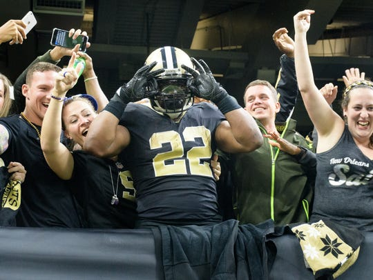 Saints runningback Mark Ingram III jumps into the stands
