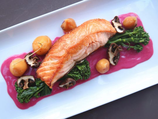 The baked steelhead fish at Liberty Station comes with mushrooms and berry butter.