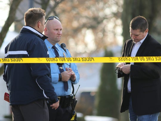 Police work the scene of an apparent murder-suicide