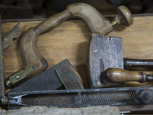 Antique tools are among the artifacts on display at