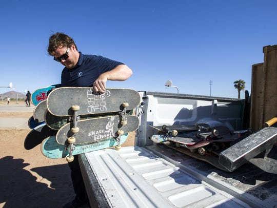 Tim Ward unloads skateboards for Skate After School