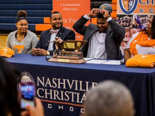 Nashville Christian senior Brant Lawless signs with the Tennessee Volunteers Wednesday afternoon. Joe Buglewicz / For The Tennessean