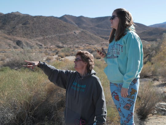 Dana Stenzel point out the San Andreas fault to her
