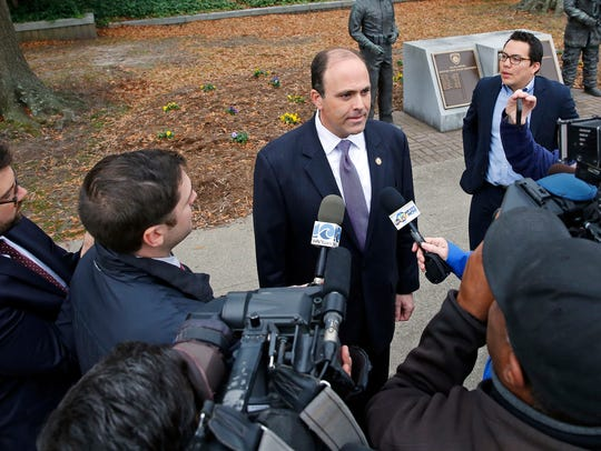 Delegate David Yancey talks with reporters outside