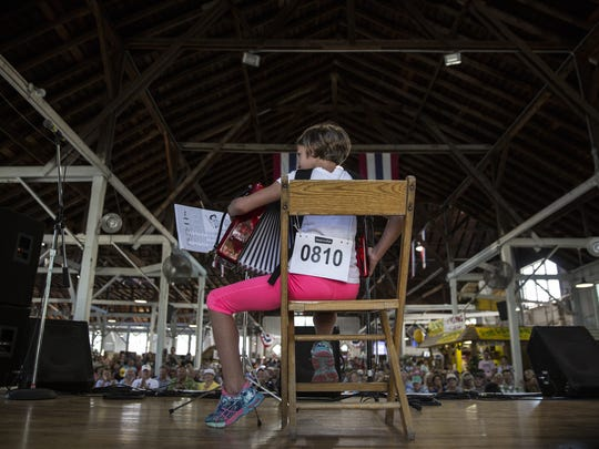 Lucy Parson competes in the accordion playing contest in Pioneer Hall on Monday, Aug. 14, 2017, at the Iowa State Fair in Des Moines.