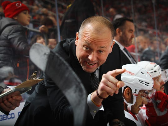 Detroit Red Wings head coach Jeff Blashill gives players