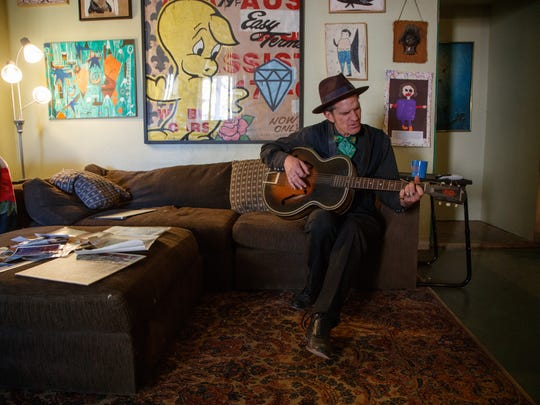 Sean Wheeler, an important member of the Palm Springs underground rock scene, plays the guitar from the couch of his Palm Springs home, December 7, 2017.