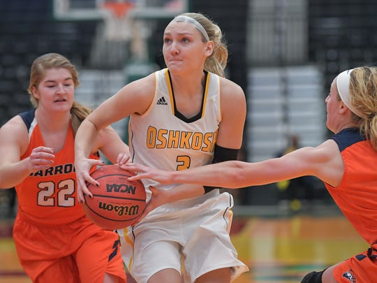 Jaimee Pitt (3) of the Titans drives toward the basket. The University of Wisconsin-Oshkosh Titans hosted the Carroll University Pioneers Saturday afternoon, December 30, 2017 at the Menomonee Nation Arena in Oshkosh.