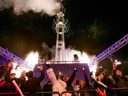 """The crowd cheers as the giant """"D"""" drops at midnight during """"The Drop"""" event at Beacon Park in Detroit, MI on January 1, 2018 to ring in the new year."""